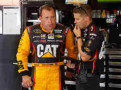 Ryan Newman, driver of the #31 Caterpillar Chevrolet, left, talks with crew chief Lucas Lambert in the garage area - Photo Credit: Joe Robbins/Getty Images