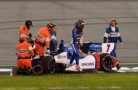 Mikhail Aleshin of Russia driver of the 7 Schmidt Peterson Motorsports gets out of his car holding his left wrist after crashing with Takuma Sato of Japan driver of the #14 A J Foyt Enterprises Dallara Honda during the Verizon IndyCar Series Iowa Corn Indy 300 presented by DEKALB at the Iowa Speedway on July 12, 2014 in Newton, Iowa.  (Photo Credit: Robert Laberge / Getty Images)