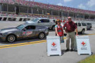 """American Red Cross Community Chapter Executive Peggy Mann (left) and Talladega Superspeedway Chairman Grant Lynch (right) get ready for the """"Fan Track Drive"""" event on July 26, which will give fans the opportunity to drive around the historic 2.66-mile track in their passenger cars."""