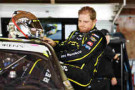Justin Marks, driver of the #31 SOL Republic Chevrolet, climbs into his car before practice for the Nationwide Children's 200 at Mid-Ohio Sports Car Course on August 15, 2014 in Lexington, Ohio. - Photo Credit: Jamie Sabau/Getty Images