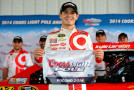 Kyle Larson, driver of the #42 Target Chevrolet, poses with the Coors Light Pole Award after qualifying for the NASCAR Sprint Cup Series GoBowling.com 400 at Pocono Raceway on August 1, 2014 in Long Pond, Pennsylvania. - Photo Credit: Jared C. Tilton/Getty Images