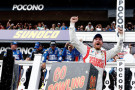 Dale Earnhardt Jr., driver of the #88 Michael Baker International Chevrolet, celebrates in Victory Lane after winning the NASCAR Sprint Cup Series GoBowling.com 400 at Pocono Raceway on August 3, 2014 in Long Pond, Pennsylvania. - Photo Credit: Jeff Zelevansky/Getty Images