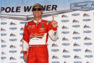 Kevin Harvick, driver of the #4 Budweiser Chevrolet, poses after qualifying on pole for the NASCAR Sprint Cup Series AAA 400 at Dover International Speedway on September 26, 2014 in Dover, Delaware. - Photo Credit: Patrick Smith/Getty Images
