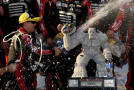 Jeff Gordon, driver of the #24 Drive To End Hunger Chevrolet, celebrates with his team in Victory Lane after winning the NASCAR Sprint Cup Series AAA 400 at Dover International Speedway on September 28, 2014 in Dover, Delaware. - Photo Credit: Nick Laham/Getty Images