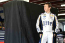 Brad Keselowski, driver of the #2 Miller Lite Ford, stands in the garage area during practice for the NASCAR Sprint Cup Series Sylvania 300 at New Hampshire Motor Speedway on September 19, 2014 in Loudon, New Hampshire. - Photo Credit: Jonathan Ferrey/Getty Images