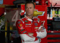 Kevin Harvick, driver of the #4 Budweiser Chevrolet, stands in the garage area at Dover International Speedway on September 26, 2014 in Dover, Delaware. - Photo Credit: Getty Images