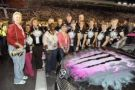 "Kyle and Samantha Busch with ""Project Pink Champions"" at last year's Nationwide Series race at Charlotte Motor Speedway"