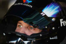 2014 NSCS Driver Denny Hamlin (FedEx) up close with helmet on - Photo Credit: Jerry Markland/Getty Images