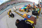 Kyle Busch, driver of the #18 M&M's Toyota, pits during the NASCAR Sprint Cup Series Ford EcoBoost 400 at Homestead-Miami Speedway on November 16, 2014 in Homestead, Florida. - Photo Credit: Chris Graythen/Getty Images