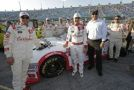 Kyle Larson with car owner Harry Scott and members of the Turner Scott Motorsports team