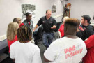 Ryan Newman talks with members of the Martinsville High School football team, during his September visit. - Photo CreditCredit: Ken Childs