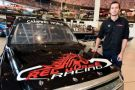Ben Kennedy poses for a photo opportunity with the #11 Red Horse Racing Toyota during the Red Horse Racing announcement at NASCAR Hall of Fame on December 17, 2014 in Charlotte, North Carolina. Kennedy will drive the #11 Red Horse Racing Toyota starting in Daytona for the 2015 season. (Photo Credit: Jared C. Tilton / Getty Images)