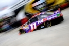 Denny Hamlin, driver of the #11 FedEx Express Toyota, drives through the garage area during practice for the NASCAR Sprint Cup Series STP 500 at Martinsville Speedway in Martinsville, Virginia. - Photo Credit: Justin Edmonds/Getty Images