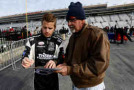 Cale Conley, driver of the #14 Toyota, signs an autograph for a fan - Photo Credit: Kevin C. Cox/Getty Images