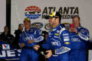 Jimmie Johnson, driver of the #48 Lowe's Chevrolet, celebrates with champagne in victory lane after winning the NASCAR Sprint Cup Series Folds of Honor QuikTrip 500 at Atlanta Motor Speedway on March 1, 2015 in Hampton, Georgia. - Photo Credit: Jerry Markland/Getty Images
