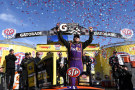 Denny Hamlin, driver of the #11 FedEx Express Toyota, celebrates in Victory Lane after winning the NASCAR Sprint Cup Series STP 500 at Martinsville Speedway on March 29, 2015 in Martinsville, Virginia. - Photo Credit: Alex Goodlett/Getty Images