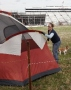 Catherine Taylor of Roanoke, Va., works to put up her tent in the Martinsville Speedway campground.