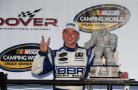 Tyler Reddick, driver of the #19 BBR Music Group Ford, poses with the Miles the Monster trophy in Victory Lane after winning the NASCAR Camping World Truck Series Lucas Oil 200 at Dover International Speedway on May 29, 2015 in Dover, Delaware. - Photo Credit: Sean Gardner/Getty Images