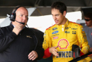 2015 NSCS Driver, Joey Logano Speaks with Crew Member - Photo Credit: Maddie Meyer/Getty Images