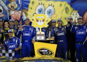 Jimmie Johnson, driver of the #48 Lowe's Chevrolet, poses with his team in Victory Lane after winning the NASCAR Sprint Cup Series SpongeBob SquarePants 400 at Kansas Speedway on May 9, 2015 in Kansas City, Kansas. - Photo Credit: Jamie Squire/Getty Images
