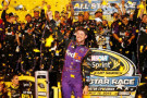 Denny Hamlin, driver of the #11 FedEx Express Toyota, celebrates in victory lane after winning the NASCAR Sprint Cup Series Sprint All-Star Race at Charlotte Motor Speedway on May 16, 2015 in Charlotte, North Carolina. - Photo Credit: Jerry Markland/Getty Images
