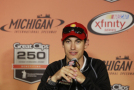 2015 NASCAR Driver, Joey Logano speaks with the media at Michigan International Speesdway. - Photo Credit: Brian Lawdermilk/Getty Images