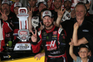 Kurt Busch, driver of the #41 Haas Automation Chevrolet, Gene Haas, co-owner of Stewart Haas Racing, and his team pose in an alternate Victory Lane after winning the NASCAR Sprint Cup Series Quicken Loans 400 at Michigan International Speedway on June 14, 2015 in Brooklyn, Michigan. - Photo Credit: Chris Trotman/Getty Images