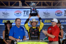 Matt Crafton, driver of the #88 Ideal Door/Menards Toyota, celebrates with the trophy after winning the NASCAR Camping World Truck Series WinStar World Casino & Resort 400 at Texas Motor Speedway on June 5, 2015 in Fort Worth, Texas. - Photo Credit: Robert Laberge/Getty Images