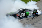 Kyle Busch, driver of the #54 Monster Energy Toyota, celebrates with a burnout after winning the NASCAR XFINITY Series Great Clips 250 Benefiting Paralyzed Veterans of America at Michigan International Speedway on June 13, 2015 in Brooklyn, Michigan. - Photo Credit: Robert Laberge/Getty Images