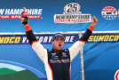 Denny Hamlin, driver of the #20 Sun Energy 1 Toyota, celebrates in Victory Lane after winning the NASCAR XFINITY Series Lakes Region 200 at New Hampshire Motor Speedway on July 18, 2015 in Loudon, New Hampshire. - Photo Credit: Maddie Meyer/Getty Images