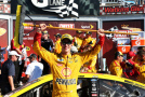 Joey Logano, driver of the #22 Shell Pennzoil Ford, celebrates in victory lane after winning the NASCAR Sprint Cup Series Cheez-It 355 at the Glen at Watkins Glen International on August 9, 2015 in Watkins Glen, New York. - Photo Credit: Todd Warshaw/Getty Images