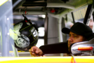 Matt Crafton, driver of the #88 Ideal Door/Menards Toyota, sits in his truck during practice for the NASCAR Camping World Truck Series Careers for Veterans 200 at Michigan International Speedway on August 14, 2015 in Brooklyn, Michigan. - Photo Credit: Rey Del Rio/Getty Images