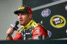 Clint Bowyer, driver of the #15 5-hour Energy Toyota, speaks to the media during a press conference prior to practice for the NASCAR Sprint Cup Series Irwin Tools Night Race at Bristol Motor Speedway on August 21, 2015 in Bristol, Tennessee. - Photo Credit: Tom Pennington/Getty Images