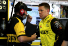 Carl Edwards, driver of the #19 Stanley Toyota, right, talks with crew chief Darian Grubb in the garage area during practice for the NASCAR Sprint Cup Series Windows 10 400 at Pocono Raceway in Long Pond, Pennsylvania. - Photo Credit: Jerry Markland/Getty Images