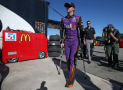 Denny Hamlin, driver of the #11 FedEx Express Toyota, walks through the garage area during practice for the NASCAR Sprint Cup Series Federated Auto Parts 400 at Richmond International Raceway on September 11, 2015 in Richmond, Virginia. - Photo Credit: Chris Graythen/Getty Images