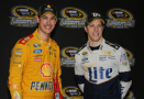 Joey Logano, driver of the #22 Shell Pennzoil Ford, and Brad Keselowski, driver of the #2 Miller Lite Ford, pose with the Sprint Cup Trophy after making the Chase for the Sprint Cup after the NASCAR Sprint Cup Series Federated Auto Parts 400 at Richmond International Raceway on September 12, 2015 in Richmond, Virginia. - Photo Credit: Jerry Markland/Getty Images