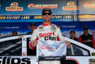 Carl Edwards, driver of the #19 Sport Clips Toyota, poses with the Coors Light Pole Award after qualifying for pole position for the NASCAR Sprint Cup Series Sylvania 300 at New Hampshire Motor Speedway on September 25, 2015 in Loudon, New Hampshire. - Photo Credit: Chris Trotman/Getty Images