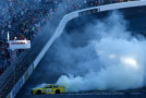 Matt Kenseth, driver of the #20 Dollar General Toyota, celebrates with a burnout after winning the NASCAR Sprint Cup Series SYLVANIA 300 at New Hampshire Motor Speedway on September 27, 2015 in Loudon, New Hampshire. - Photo Credit: Jeff Zelevansky/Getty Images