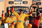 Joey Logano, driver of the #22 Shell Pennzoil Ford, celebrates in Victory Lane after winning the NASCAR Sprint Cup Series Hollywood Casino 400 at Kansas Speedway on October 18, 2015 in Kansas City, Kansas. - Photo Credit: Daniel Shirey/Getty Images