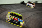 Kyle Busch, driver of the #18 M&M's Crispy Toyota, leads Kevin Harvick, driver of the #4 Budweiser/Jimmy John's Chevrolet, during the NASCAR Sprint Cup Series Ford EcoBoost 400 at Homestead-Miami Speedway on November 22, 2015 in Homestead, Florida. - Photo Credit: Robert Laberge/Getty Images
