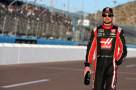 Kurt Busch, driver of the #41 Haas Automation Chevrolet, walks on the grid at Phoenix International Raceway in Avondale, Arizona. - Photo Credit: Sean Gardner/Getty Images