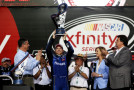 Chris Buescher, driver of the #60 Fastenal Ford, celebrates winning the series championship with the trophy in Victory Lane during the NASCAR XFINITY Series Ford EcoBoost 300 at Homestead-Miami Speedway on November 21, 2015 in Homestead, Florida. - Photo Credit: Chris Graythen/Getty Images